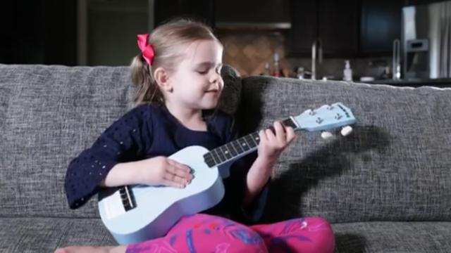 Claire plays ukulele for first time, but it's her song choice that's melting everyone's hearts
