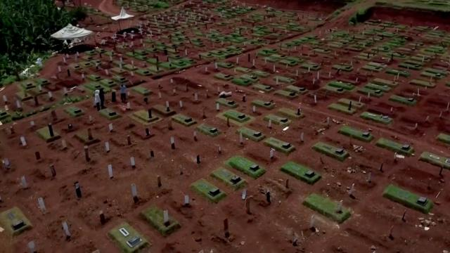 Drone video shows Jakarta's expanded COVID-19 cemetery