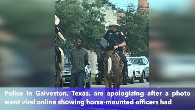 Texas police apologize after photo shows horse-mounted officers leading a handcuffed man of color by