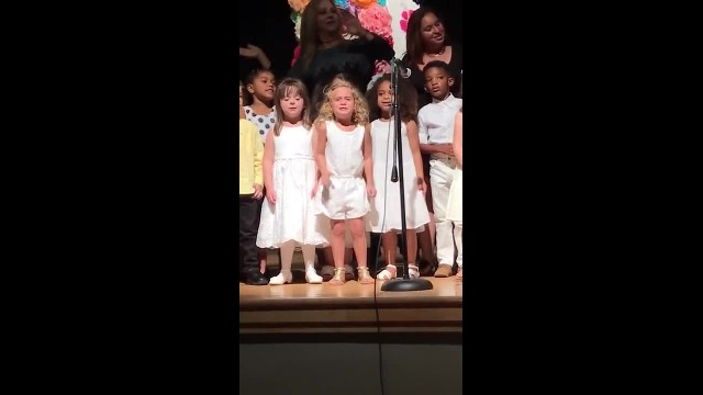 Preschoolers Line Up For Music Show As Tiny Blonde In Middle Steals Internet's Heart