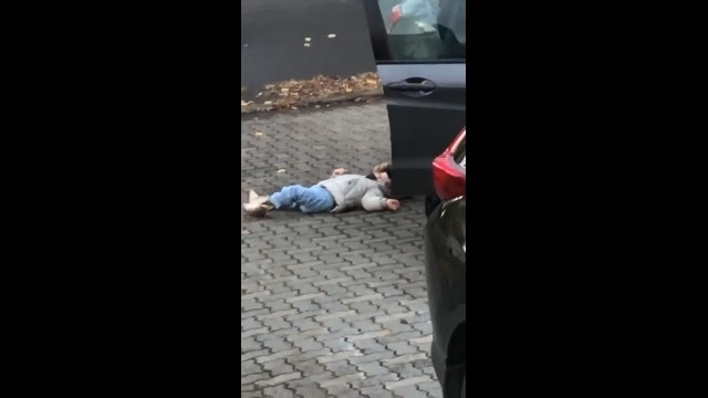 Grumpy toddler lies down and refuses to move - but her dad is having none of it