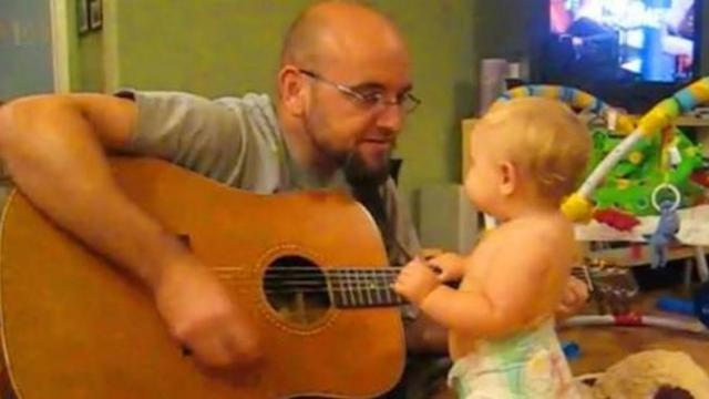 Dad plays Bon Jovi for baby daughter, has no idea she's about to witness her secret talent