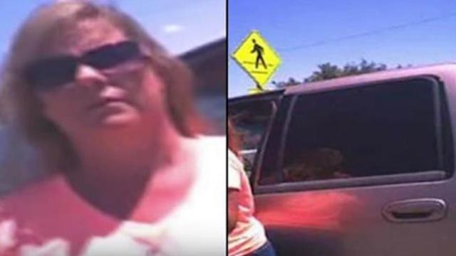 Cop orders woman to sit inside hot car after she locked her dog in. Her enraged response is golden