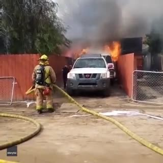 Man Ignores Firefighters' Orders, Runs Straight Into Burning House To Save His Beloved Dog