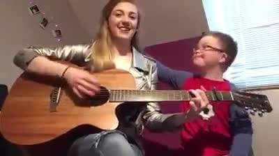 Sister films herself singing to brother with down syndrome, but has no clue she's recording viral vi