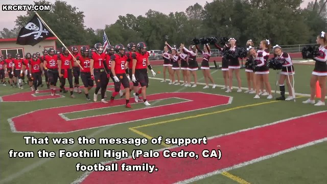 Cheerleader devastated by cancer diagnosis is left in tears when Football players toss these at her