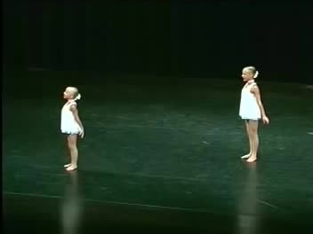 2 sisters take position onstage. Seconds later their mesmerizing routine makes the audience lose the