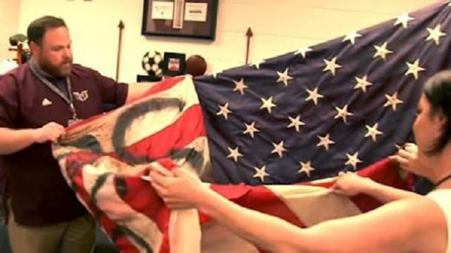 Students who graffitied American flag receive solemn lesson from veterans