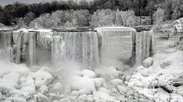 Niagara falls turns into winter wonderland as it completely freezes over