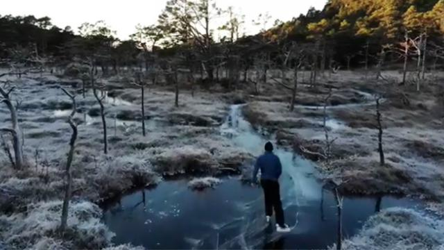 Watch this man ice skating through a Norwegian's frozen river in the middle of a forest!