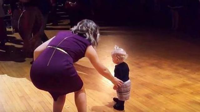 Woman Tries To Remove Toddler Off Dance Stage, Instead, Her Dance Moves Quickly Steal The Show