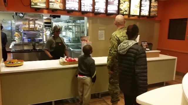 Soldier about to pay for his meal takes action when he sees two boys shivering nearby