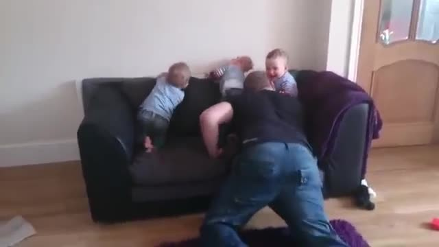 Triplets Wait Quietly On Couch, But Excitement Is Through The Roof When Dad Comes Home!