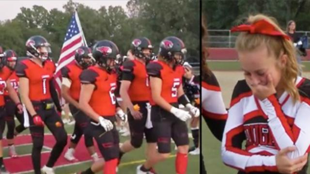 Football team leaves cheerleader speechless when they toss these at her fet before game