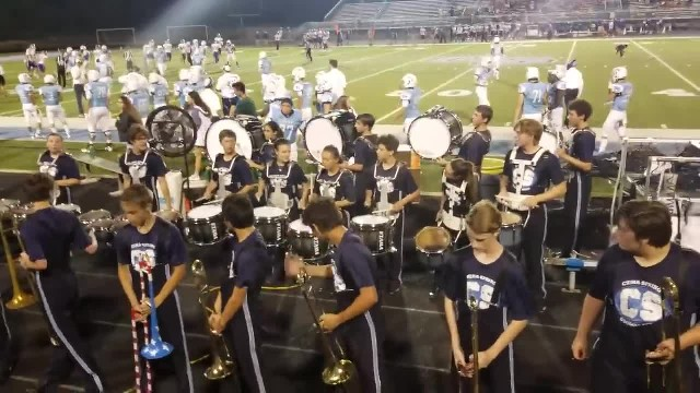 Trombone players turn around to crowd unveiling twist leaving crowd in uproar