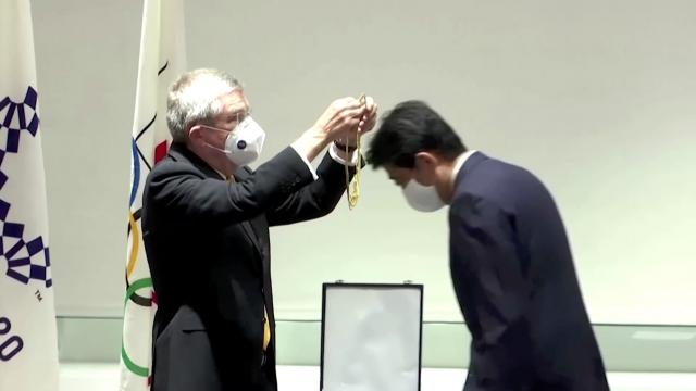 Former Japan PM Abe gets Olympics' highest honor