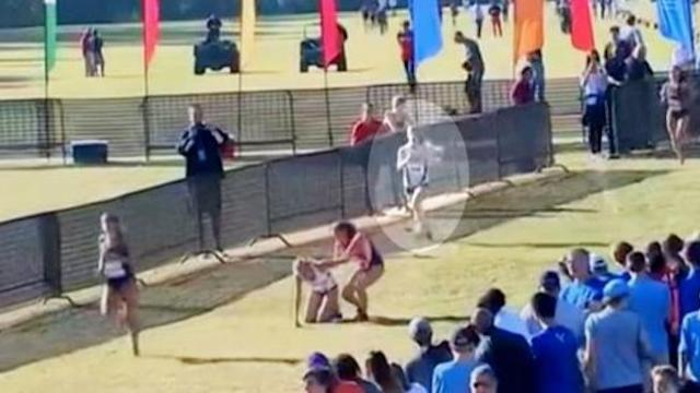 Student halts to help collapsed girl, but it's the runner behind her that's making headlines