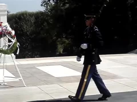 Men Laugh At Soldier Memorial Until Camera Catches Uniformed Guard Setting Them Straight