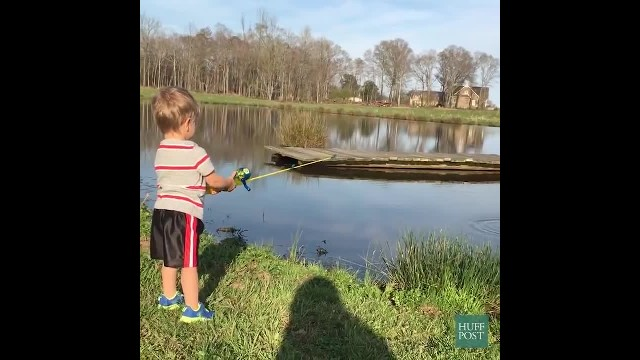 Toddler catches huge rainbow trout using toy spiderman fishing rod