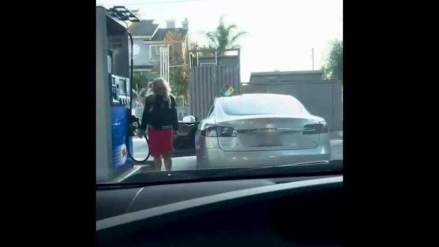 Woman Is Caught Trying To Put Gas In Tesla In Hilarious Footage