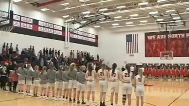 Iowa crowd's rendition of national anthem at high school basketball game goes viral