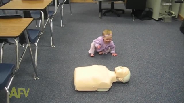 Tiny Baby Girl Toddles Up To CPR Dummy, Shocks Everyone When She Starts 'Saving' Its Life