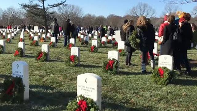 Volunteers tough out sleet and ice to do something amazing at arlington national cemetery for christ