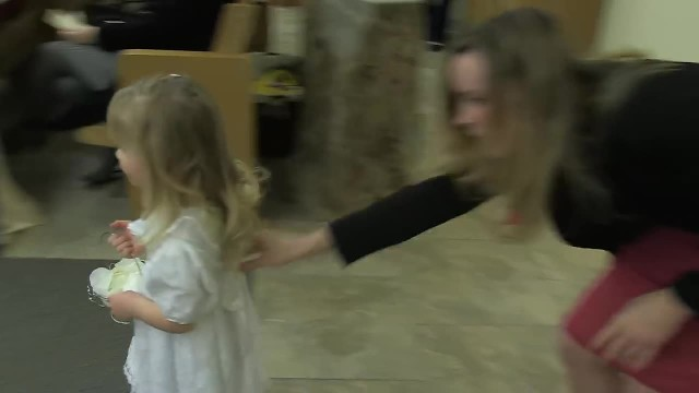 Flower girl scared to walk down aisle, crowd howling when groomsman saves the day