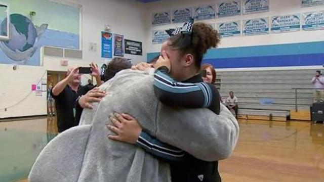 Sisters burst into tears as school mascot is revealed to be military dad