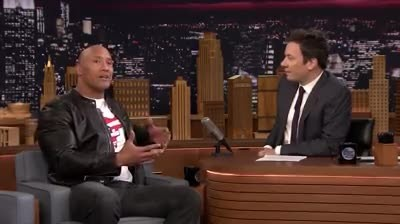 Army veteran loses it when she meets the rock, but has no clue her military husband is standing behi