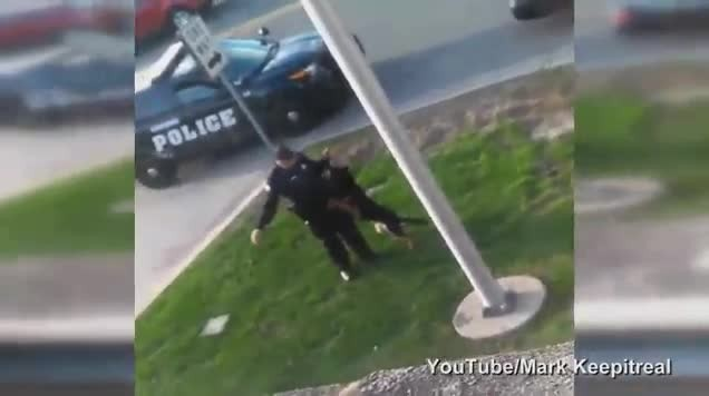 Police officer caught hitting his K9 with the leash, dangling him in mid-air