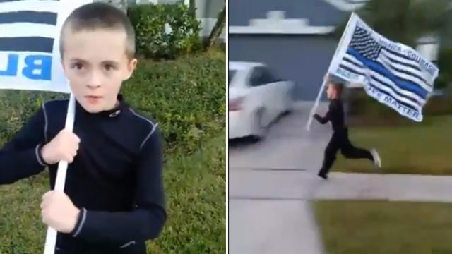 Little boy runs a mile for fallen officer with police flag held high