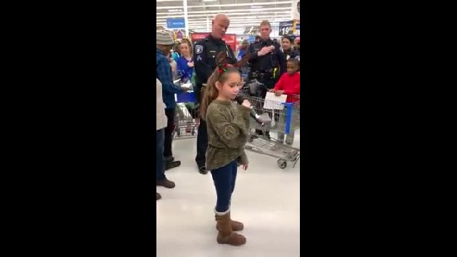 Young Girl Attends Cop Event At Walmart Making Everyone's Eyes Bulge Moment She Grabs Mic To Sing