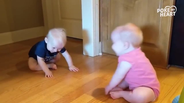 11-month-old twins keep making each other laugh, but keep your eye on baby in blue