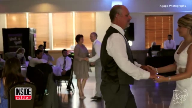 Bride stops father-daughter dance, asks dad to turn around. He looks & instantly breaks down