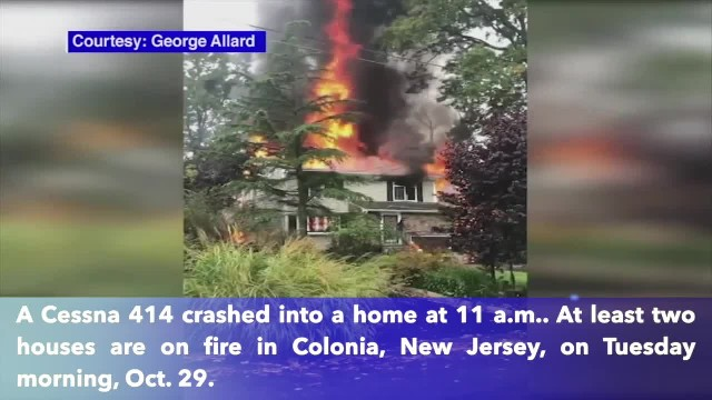 Houses on fire after plane crashes in New Jersey