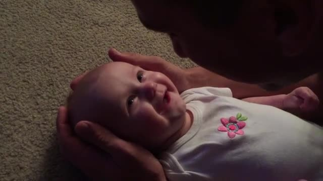 "Dad tenderly sings ""You Are So Beautiful"" to baby girl & her face says it all"