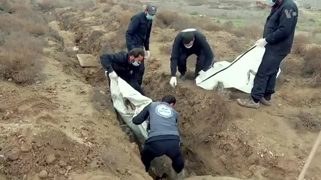 Hundreds of Bodies Exhumed From Raqqa Grave