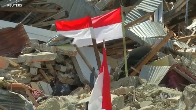 Flags Mark Sites of Trapped Bodies in Indonesia Quake