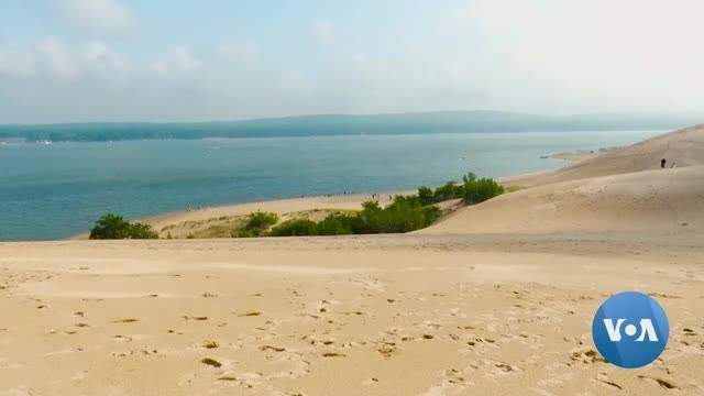 Michigan Sand Dunes Attract Tourists, Swallow Properties